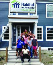 HOLLISTER FOR HABITAT: Hollister Staffing employees spent the day painting at a Dorchester site with Habitat for Humanity. Pictured, from bottom left: Steven Branch, Gulmira Maioli, Patricia Benitez, Jenn Grimes, Katie Buchta, Micaela Fouhy, Michelle Goddard, Katie Date, Liliana Hall, Lauren Weinstock, and Dave, the Habitat for Humanity site manager.