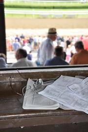 Ramsey's betting notes sit on the ledge in his box seats at Saratoga Race Course. Ramsey said he went all-in to win the owner's title this summer, and he did: 22 wins and $1.7 million of prize money accumulated.