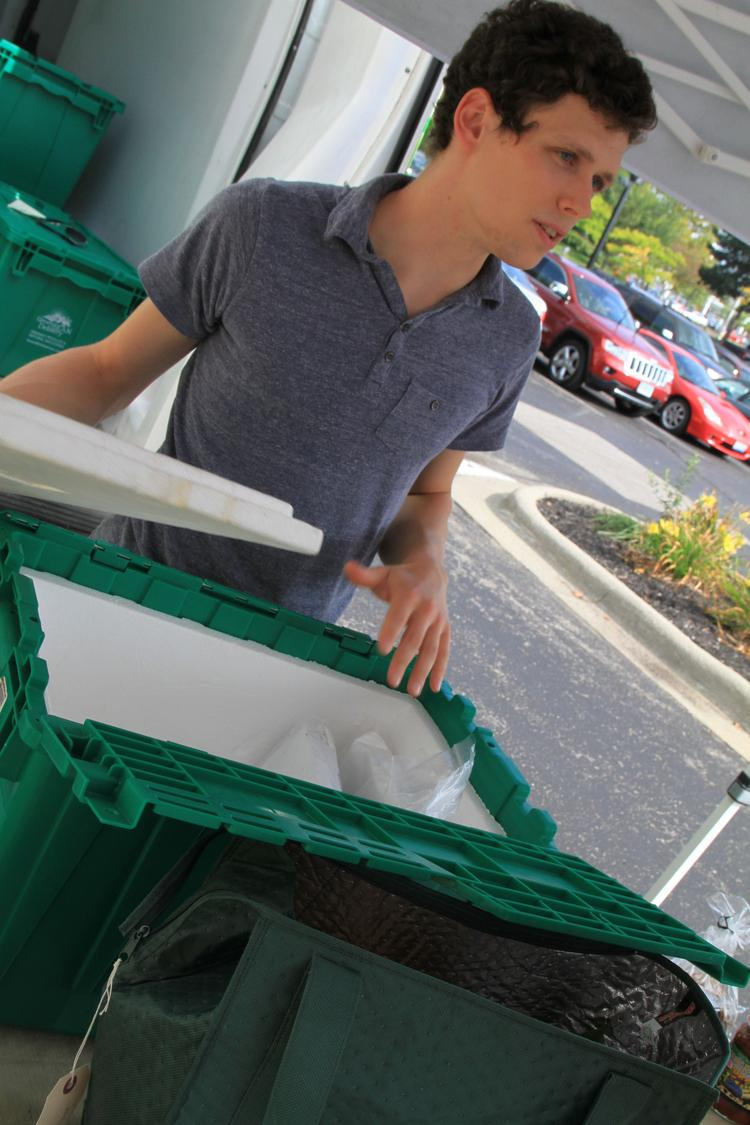 Johnny Newman, a Green Bean Delivery health and wellness service representative, brought many containers of fresh foods to Worthington Industries last week as part of the companies' new relationship.