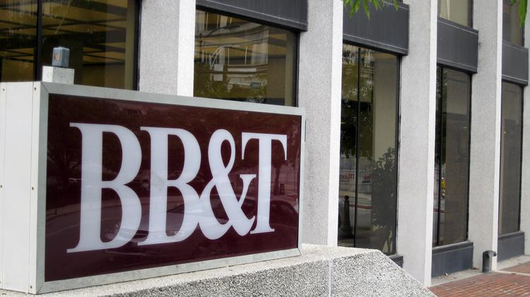 BB&T booked net income of $425 million in the second quarter, down from $547 million a year earlier in part due to $88 million worth of mortgage and tax-related reserve adjustments.
