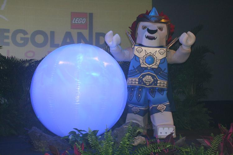 Legends of Chima character Laval stands next to an orb of Chi. Legoland Florida's World of Chima opens this summer.