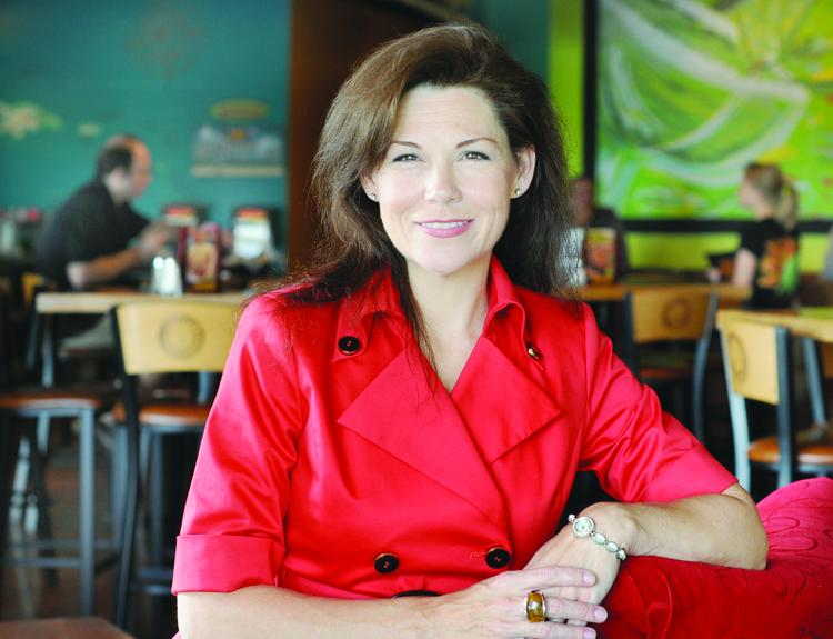 Bridget Sutton and her husband, Tony Sutton, filed for bankruptcy liquidation. Pictured in 2010, she was president of Baja Sol Restaurant Group; her husband was CEO.