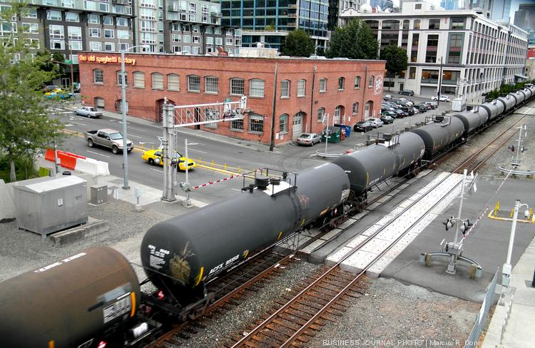 An oil train on the BNSF Railway line passes by the intersection of Broad Street and Alaskan way near Pier 70 in Seattle.