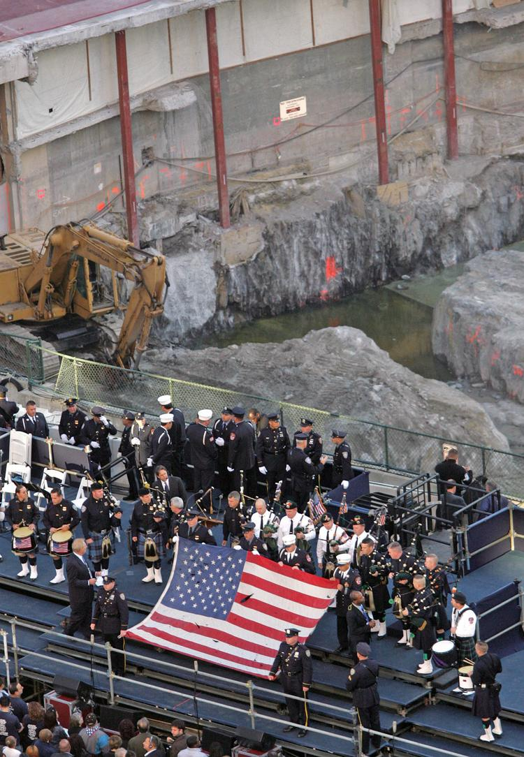 The American flag that flew over the site of the former World Trade Center until late October 2001 is displayed at Ground Zero in New York City on Sept. 11, 2006, at a ceremony commemorating the five-year anniversary of the terrorist attacks on the U.S.