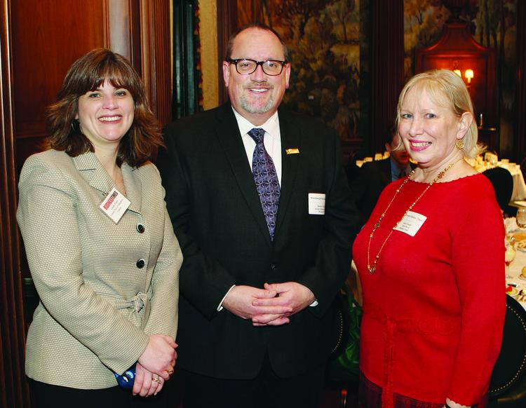 United Way of Allegheny County's Linda Jones, left, and Janice Twaddle and Dennis Gilfoyle of Junior Achievement of Western Pennsylvania at VisionPittsburgh, held Tuesday in downtown Pittsburgh. Laura Ellsworth of Jones Day was the keynote speaker.