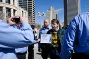 A member of the United Mine Workers of America is arrested during a protest against Peabody Energy Tuesday.