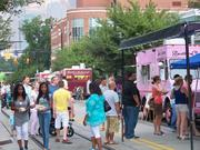 """CBJ Seen: The Elizabeth neighborhood held a block party featuring local food trucks, live music and vendors. Attendees were asked to make donations to help feed hungry families.Want to see your event included? Send photos and caption information in an email to aangel@bizjournals.com, with """"CBJ Seen"""" in the subject line."""