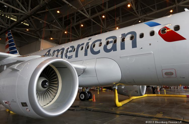 Members of the media view the American Airlines Inc. Airbus A319 at Dallas Fort Worth Airport in Fort Worth, Texas this summer.