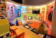 """A lounge area in the 1968 exhibit highlights television shows viewed in living rooms that year, including the Pittsburgh-based """"Mister Rogers' Neighborhood."""""""