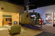 A Huey helicopter flown in Vietnam is part of the 1968 display. It's the largest item ever displayed in the Heinz History Center, and it requires a specially trained group of military veterans to take it apart and put it back together as it travels the country.