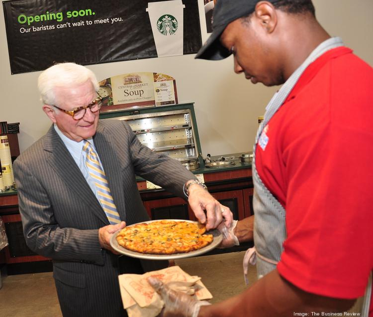 At Market Bistro by Price Chopper in Latham, NY, chairman Neil Golub with employee Anthony Johnson, sampling stone fired pizza