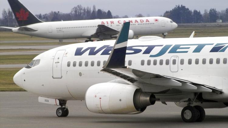 A WestJet Airlines aircraft leaves the gate as an Air Canada Jazz passenger jet taxis to & WestJet adds more international flights to Phoenix-Mesa Gateway ...