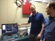 Chris Doerfler, left, and Anatoli Oleymik, discuss the monitoring capability of 3DFS' power controller.