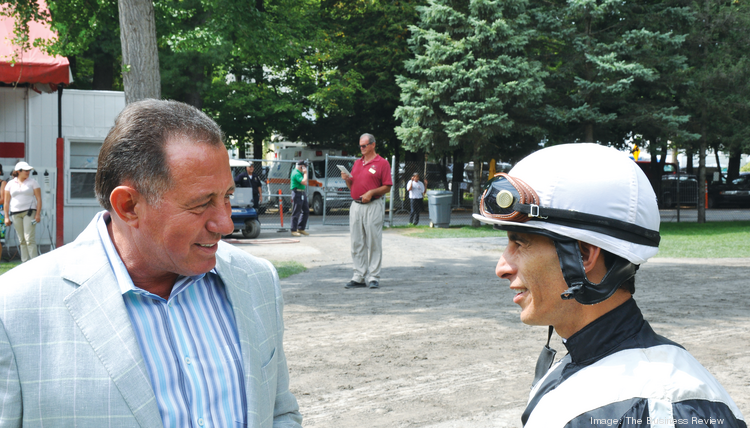 """""""Glad you're riding us,"""" horse owner and businessman Roddy Valente tells legendary jockey John Velazquez minutes before post time."""