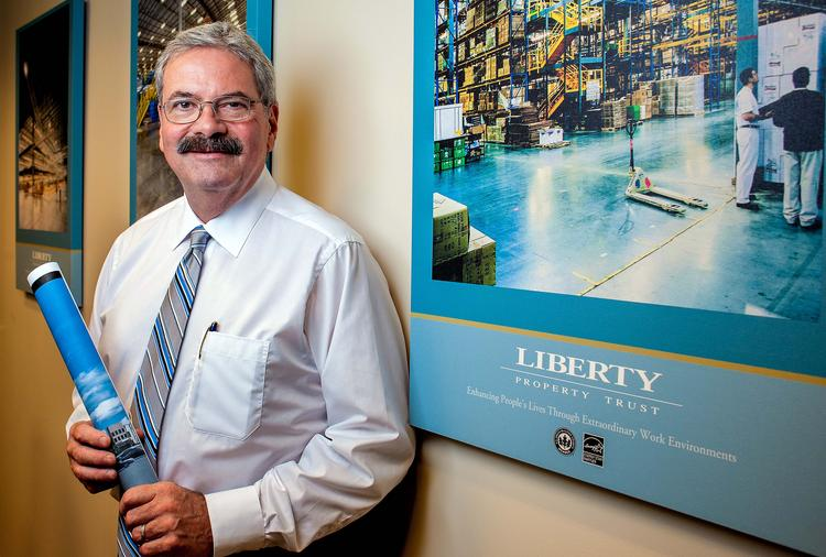 Robert E. Fenza is executive vice president and chief operating officer of Liberty Property Trust going over plans for warehouse development.