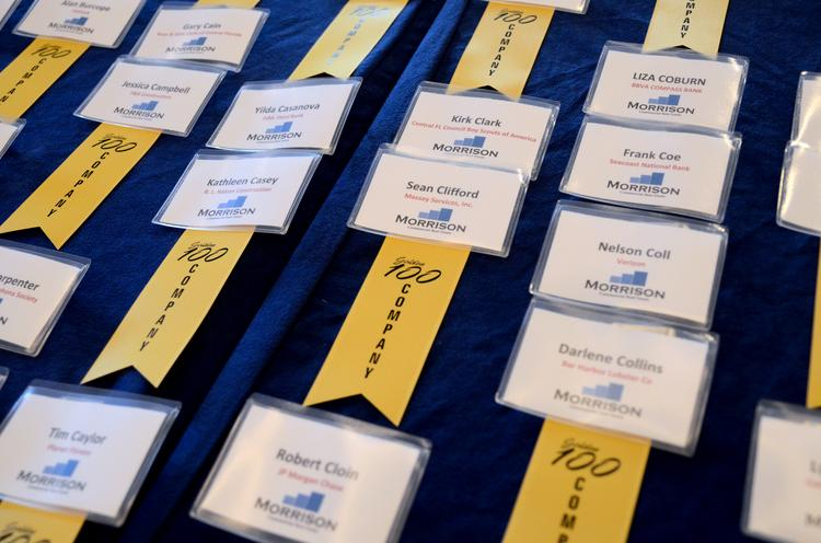 Name tags line a reception table at the Hilton Orlando before the start of the 29th annual Golden 100 Awards.
