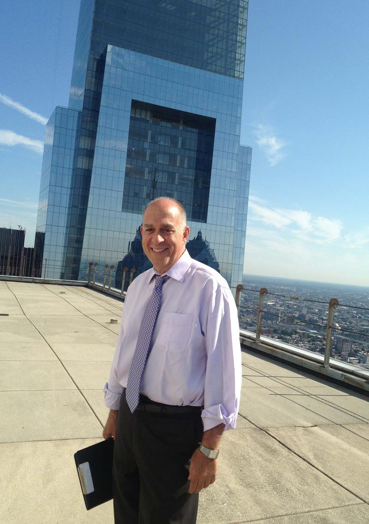 Marty Tuzman on top of Mellon Bank Center, one of the Center City office towers his company works on.