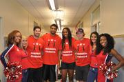 Washington Capitals forward Troy Brouwer, Washington Wizards forward Glen Rice Jr., Washington Mystics basketball operations assistant Jessica Moore and Washington Capitals forward Nicklas Backstrom posed with team cheerleaders.