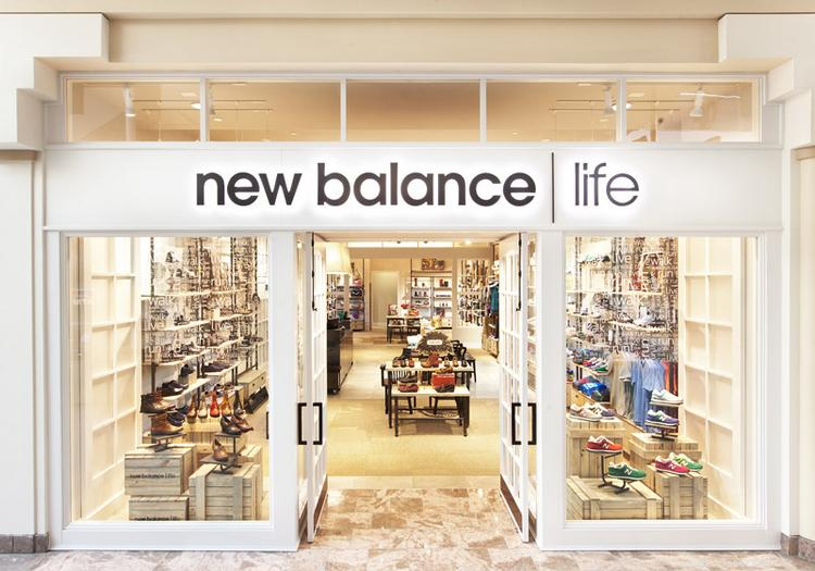 New Balance has opened a new store at the Burlington Mall to draw attention to its casual shoe lines.