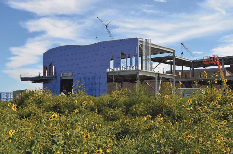 Construction continues on the $28 million Museum of Prairiefire, which has been selected to host traveling exhibits from the American Museum of Natural History.
