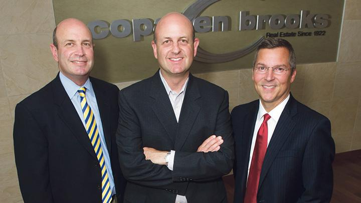 The owners of Copaken Brooks are (from left) Keith Copaken, brother Jon Copaken and Bucky Brooks.