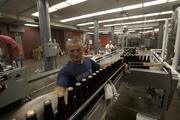 Bottles are cleaned as they move to the labeling machine.