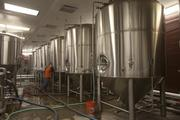 Fermenters go through a thorough cleaning between batches of beer.