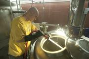 Brewer Mike Carver cleans equipment in the brewing room.
