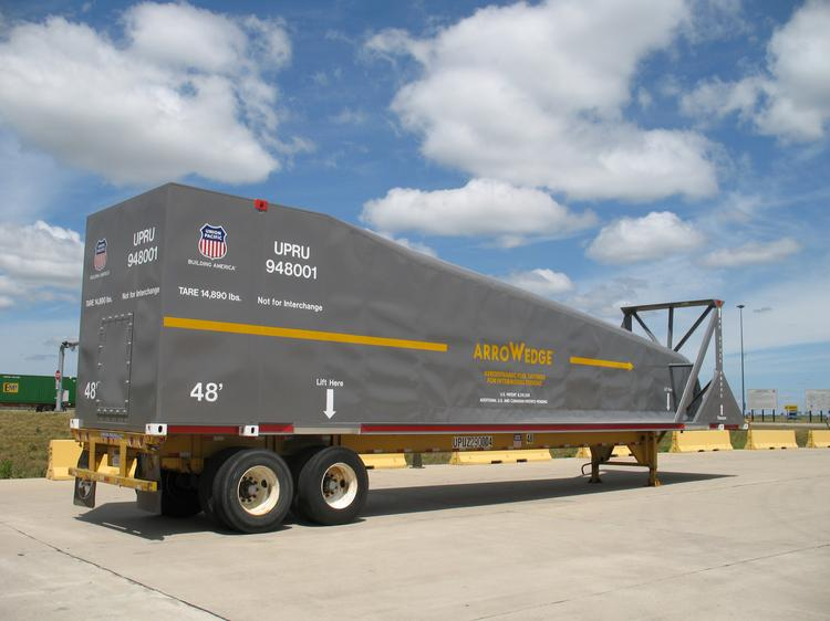 The Arrowedge is designed to sit on top of the first container on a Union Pacific train, immediately behind the lead locomotive. It sits on top of a  container. It does not move product. It is only there to reduce aerodynamic drag.