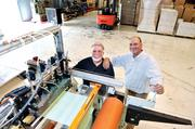 On the Entrepreneurs section, you can find the story of a Monroe company that started in distribution but found a bigger opportunity in the specialty manufacturing of tape. Pictured are ITCO International Tapes owners Bob Bullard (left) and his son, Robert Bullard Jr., with a hot-melt coater that puts adhesive onto the tape backing.