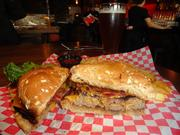 The bacon cheddar burger, and an Alaskan Amber beer, at City Oven