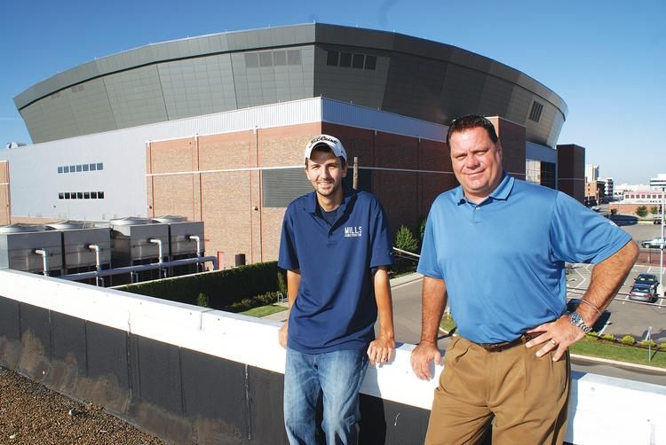 Ryan Mills and Mickey Lynch stand on the roof of Jetty's, the pizza restaurant they plan to open soon. They're among the first developers to open next door to Intrust Bank Arena, but few think they'll be the last.