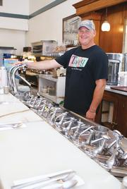 Don Wright says the arena has been a big boon to his business, Old Mill Tasty Shop, which has been in its location on Douglas Avenue for decades.