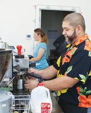 Ann and Warren Tandoc recently opened their Espresso To Go Go coffeehouse at the corner of Douglas and St. Francis, choosing the location in part for its proximity to Intrust Bank Arena.