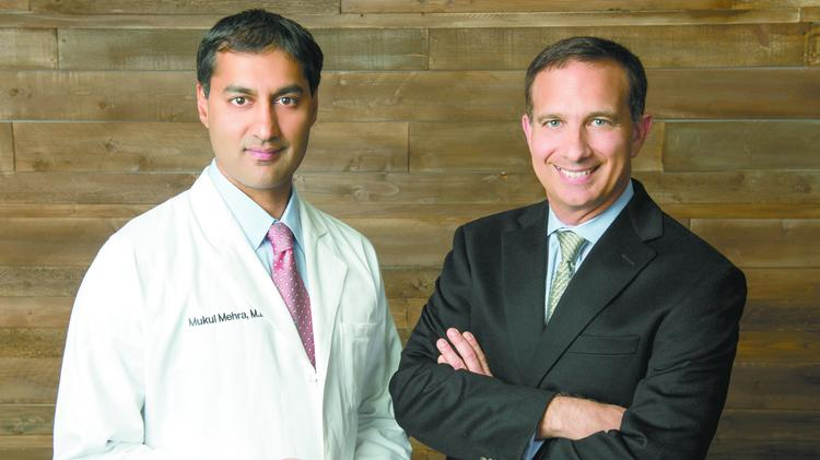 IllumiCare's G.T. LaBorde and Dr. Mukul Mehra.