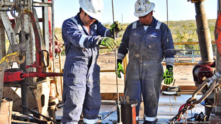 A crew works at an Eagle Ford Shale well site. Pinnergy Ltd. and Shalewater Solutions have formed a joint venture to dispose of waste water from the tracking of oil and gas wells.