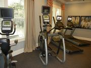 The clubhouse features a fitness room with cardio and weight machines.