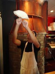 Steven Sosa, a pizza maker at City Oven, prepping dough for a pie