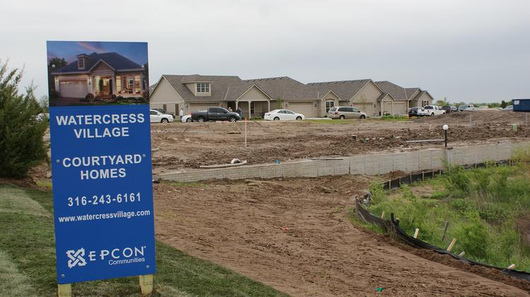 Perfection Builders' new patio home developments in west Wichita and Derby will be similar to Perfection's Watercress Village development, seen here in a file photo from 2012. However, the new homes' facades will be different.