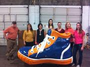 """The team from Spark Strategic Ideas, a SouthPark marketing firm, poses with a prop during a shoe drive for Samaritan's Feet.Want to see your event included? Send photos and caption information in an email to aangel@bizjournals.com, with """"CBJ Seen"""" in the subject line."""