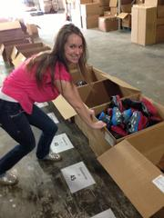 """CBJ Seen: Hannah Wilson, Spark's social-media maven, prepares to pack up a completed box of kids' size 12 shoes.Want to see your event included? Send photos and caption information in an email to aangel@bizjournals.com, with """"CBJ Seen"""" in the subject line."""