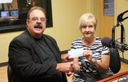 """CBJ Seen: Ron Ramsey, coordinator of the 2013 WSGE 91.7 FM Beach, Rhythm and Blues Festival receives a check for $800 from RuthAnn Steen, president of Gaston Shaggers. Want to see your event included? Send photos and caption information in an email to aangel@bizjournals.com, with """"CBJ Seen"""" in the subject line."""