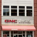 GNC paying interim CEO monthly salary of $83K plus cash incentive and use of corporate jet
