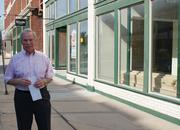 Leo Goseland, listing agent with Plaza Real Estate Inc.'s commercial division, is seen outside two of three live-work units being created on South Emporia Street in Eaton Place. Behind him on Emporia, closer to Douglas, two new businesses are planning to open in a pair of 830-square-foot spaces.
