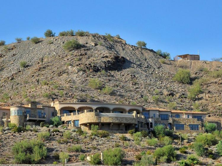 This mansion in Paradise Valley on Mummy Mountain was built in 2008 and has never been occupied. It's now on the market for close to $15 million. Click through for more photos of the home.