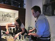 Todd Thrasher, right, of EatGoodFood Group mixes up cocktails at the 2013 RAMMYs nominations party.
