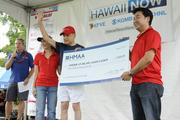 Dan Cooke, left, recognizes HMAA as a supporting sponsor the the American Heart Association's 5K Heart Walk. From left, Lori Suan,  John Henry Felix and Hiro Itho, pose for a photo.