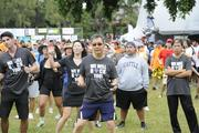 Michael Han, center, president of the Wedding Ring Shop, warms up to some aerobic exercises just before the American Heart Association's 5K Heart Walk held at Kapiolani Park.