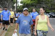 From left, Randy Aina, senior vice president of Edward Enterprises and his daughter, Charlotte Aina, participate in the American Heart Association's 5K Heart Walk at Kapiolani Park.