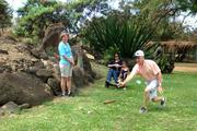 More than 60 juvenile arthritis campers and their families joined the Arthritis Foundation Hawaii board of directors for a day at the Makaha Valley Riding Stables for Camp Manaolana Family & Friends Day. Here Martin Welch, CEO of HEMIC, right, plays traditional Hawaiian games with campers.